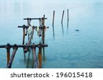 Rusty Jetty In The Clear Water...