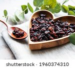 Dried Grapes  Raisins On A Grey ...