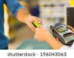 customer paying with credit... | Shutterstock . vector #196043063