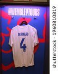 Small photo of Wembley, London, UK; december 20, 2019. Historic t-shirt worn by Liverpools Steven Gerrard in the English football team displayed in the dressing room of Wembley Stadium. Illustrative.