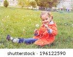 girl on grass with dandelion... | Shutterstock . vector #196122590