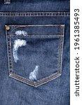 Small photo of Blue worn jeans pocket close up, ripped jeans pocket background, dark blue damaged denim backdrop, torn jeans pocket pattern, shabby indigo color jeans cloth, grunge pants back, old vintage trousers