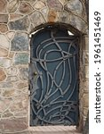 Old metal door in stone wall....