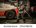 Firefighter Holding Water Hose...