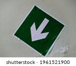 Green indoor warning sticker...