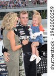 Small photo of Long Pond, PA, USA - July 28, 2019: NASCAR driver Ty Dillon and his family await the start of the 2019 NASCAR Gander Outdoors 400 at Pocono Raceway in Pennsylvania.