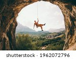 Rock Climber Hanging On A Rope. ...
