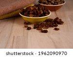 Dried Raisins In A Bowl On A...
