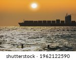 A Silhouette Of A Cargo Ship At ...