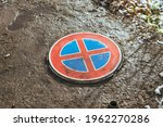 Wet Red Road Sign As Sewerage...