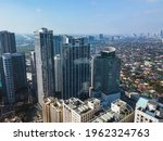 Aerial of Eastwood city skyline and cityscape along C5. Libis, Quezon City, Philippines.