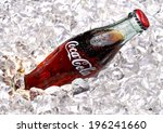 Small photo of ANKARA - TURKEY - June 1, 2014 250ml Classic Coca-Cola bottle with ice. Coca-Cola Company is the most popular market leader in Turkey.