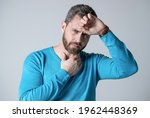 Small photo of mature man with beard has heacache suffer from headahce on grey background, malaise.