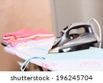 iron and cloth | Shutterstock . vector #196245704
