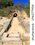 Small photo of Entrance tunnel to the stadium near the sanctuary of ancient Nemea, Greece