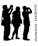 women and man with a camera on...   Shutterstock . vector #196282970