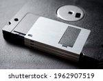 Old Floppy Disks On A Black...