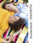 two woman lying on a blanket in ... | Shutterstock . vector #196298753
