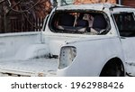 An Old Abandoned White Pickup...