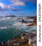 Small photo of Hayle, UK - October 13, 2020: Autumn evening light and a north easterly gale on Godrevy Island, Cornwall, UK