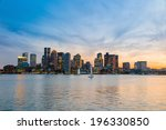 Stock photo boston downtown skyline panorama with skyscrapers over water at twilight 196330850