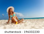 Girl Sunbathing On White Sand...
