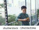 Happy Man Using Mobile Phone At ...