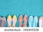 female fashion shoes on blue... | Shutterstock . vector #196345328