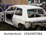 A White Hatchback Car With Open ...