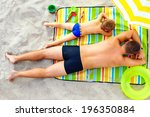 father and son sunbathing on... | Shutterstock . vector #196350884