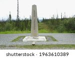 International boundary pillar between Yukon, Canada and Alaska, United States borders in vast wildness of boreal forest