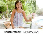 young smiling girl preparing an ... | Shutterstock . vector #196399664