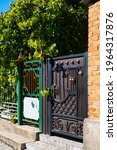 Wooden Gate With Wrought Iron...