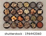 Small photo of Large traditional chinese herbal medicine selection in wooden bowls.