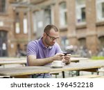 young man drinking coffee in... | Shutterstock . vector #196452218