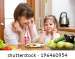 mother and kid cooking and... | Shutterstock . vector #196460954