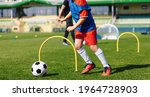 Child Playing Soccer Ball On...