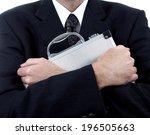 a man holding a briefcase close ...   Shutterstock . vector #196505663