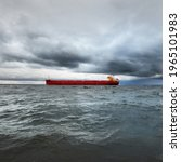 Large Red Cargo Ship Sailing In ...