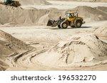 Excavator Working On Sand Dunes