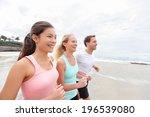 Group Running On Beach Jogging. ...