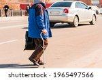 Unidentified Old Man In Blue...