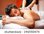 man having a massage in a... | Shutterstock . vector #196550474