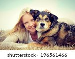 Stock photo a happy young woman and her german shepherd dog are laying on the grass outside hugging vintage 196561466
