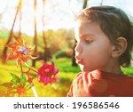 Portrait Of A Cute Boy Blowing...