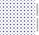 Floral seamless pattern in retro style. Small blue flowers on a white background. Vector.