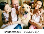 a young friendly family of four ... | Shutterstock . vector #196619114