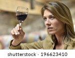 woman tasting red wine in cellar | Shutterstock . vector #196623410