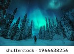 Man Watching Aurora Borealis In ...