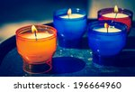 Four Candles In Colorful Glass...